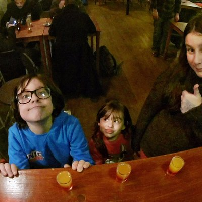 Kids having a virgin shot at the Bar