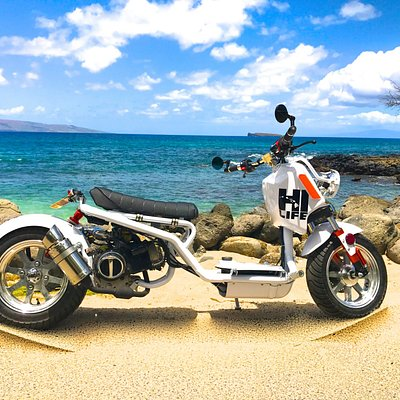 Step off your scooter into the crystal clear waters of Maui...