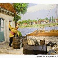 Un quai de Loire avec des marchandises.