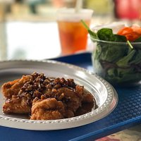 The chicken-fried chicken with honey pecan sauce and salad with Josephine's greens
