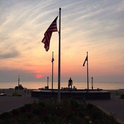 Sunrise on boardwalk Navy SEAL Monument.
