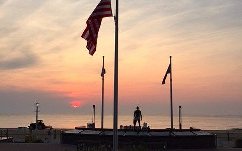 Sunrise on boardwalk Navy SEAL Monument.