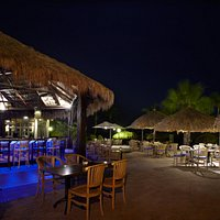 Enjoy Caribbean cocktails at our bar, right on the beach
