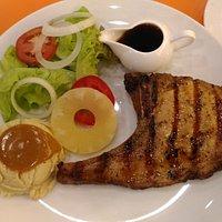 Kurbu pork chop with mashed potato and salad