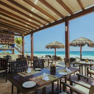 dine al fresco at our restaurant on the beach