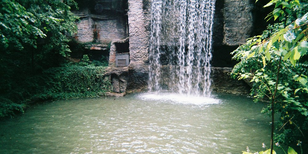 Beautiful waterfall inside Silver Dollar City next to many of the dining areas