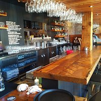 The bar at Wayfinder beer is sleek and modern