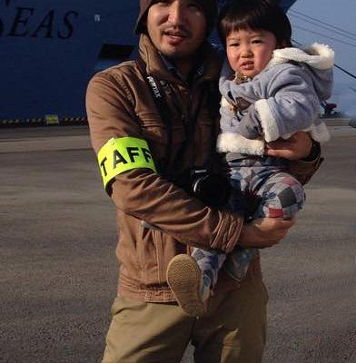 This is me and my son, in front of a cruise ship at Yatsushiro port.