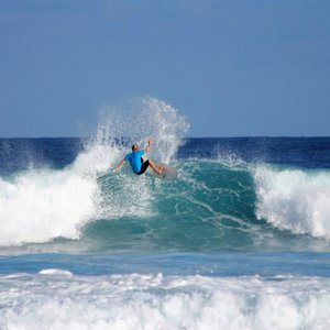 Surf with us. We work with all skill levels.