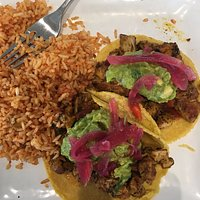 chicken tacos with a side of mexican rice