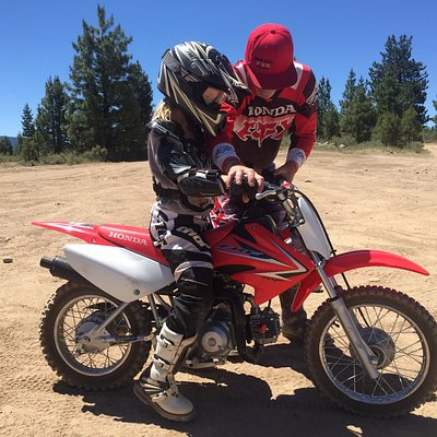 Ayla (age 7) learning to ride on a CRF70