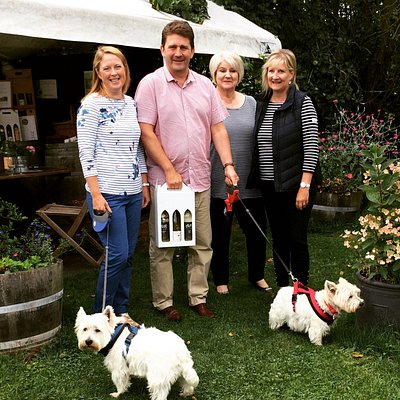 Our tasting tent with happy voucher visitors. Our vouchers include 3 bottles to choose and take.