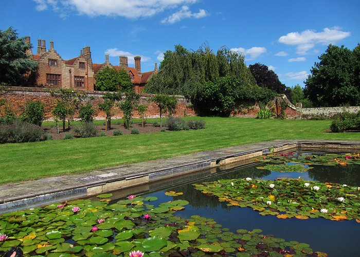 The walled garden and lily pond and Ingatestone Hall beyond.