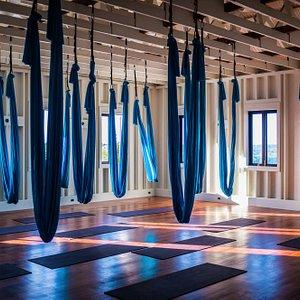 Aerial Yoga Studio with Santa Maria Belizean Hardwood Floors, 12 foot lofted ceilings, 34 Mats