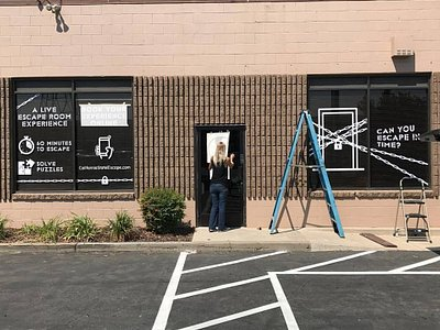 Amber installing the window decals at California State Escape
