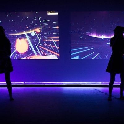 Visitors play Audioshield at The Rabbit Hole VR. Photo Credit: Jason Bihler Photography
