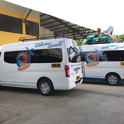 Tropical Tours Shuttles Minibuses at bus stop in Guanacaste