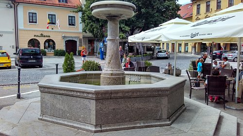 Fountain honoring poet Dragotin Kette whose song is engraved on fountain