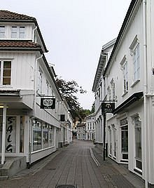 Streets in Grimstad. Tight and cosy with white houses and blue doors.