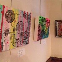 Farah Husain's fantastic artwork reflects in the frame of Alex Grey's Cosmic Christ