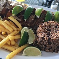 Fried whole red snapper with plantains, fries, rice and beans from Lighthouse Cafe