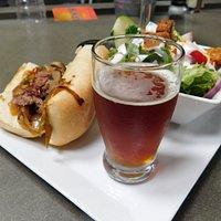 Rib Eye Sandwich with House Salad and Duck Rabbit Barley Wine
