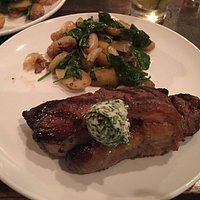 NY Strip Steak with fingerling potatoes, spinach and onions.