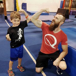 Coach Ryan Stratis with one of our young ninjas.