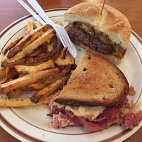 half Reuben and half burger and fries