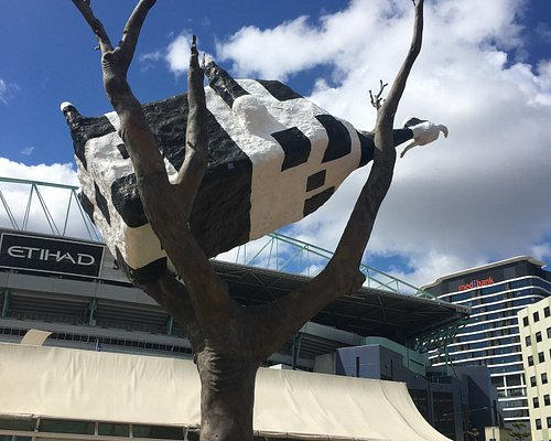 Cow Up a Tree Sculpture