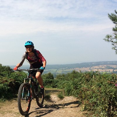 Mountain biking on East Hill, Sidmouth, Devon with a view west