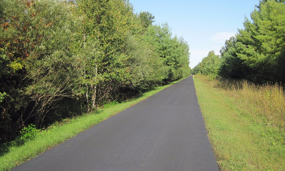 straight, wide and paved trail