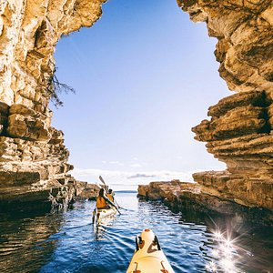 Paddling into caves along Hobart's coastline - Hobart's Cliffs, Caves and Beaches tour