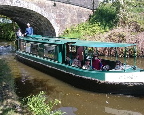 Crossley, our green boat, now with a roof covering the front deck.