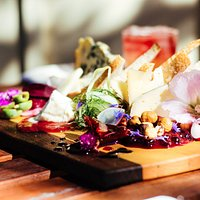 Our infamous cheeseboard. A beautiful display of local & seasonal bread, cheese, pickles, and ja