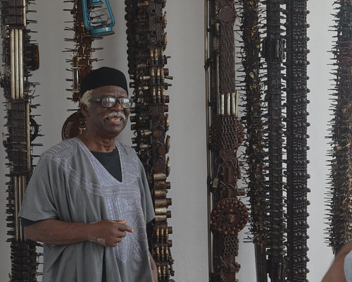 Prof. Bruce Onobrakpeya in front of the famous installation of keys in Ovuomaroro Gallery