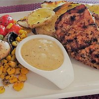 Masa succulent grilled chicken breast with grilled veggies and special sauce