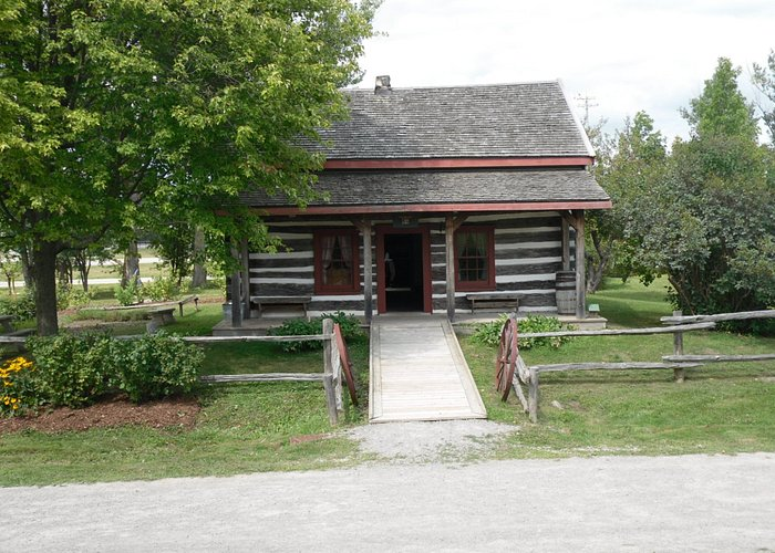 Small wood log cabin. The cabin was built c.1866, the first resident were the Perraults.