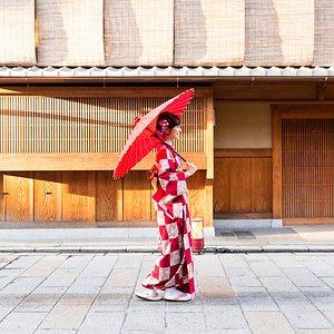 A traditional Geisha woman walks through Kyoto.