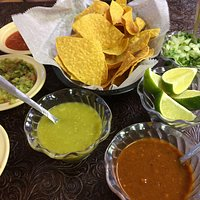 Chips, salsa, tacos and toppings. Yum!