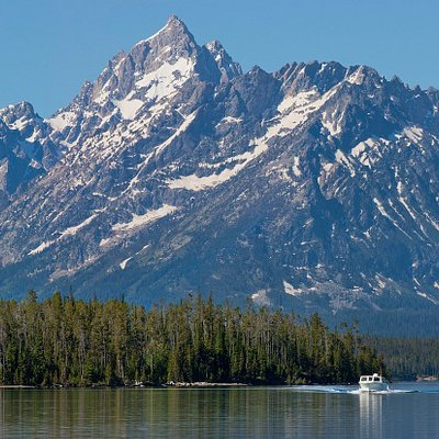 Cruise Jackson Lake to the base of the Teton Mountain Range.