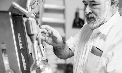 Greg Stark filling bottles