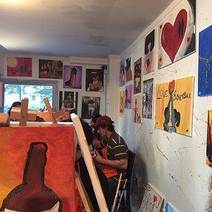 Artwork lining the walls.
