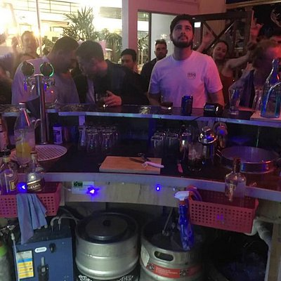 Shot of the crowd from behind the bar