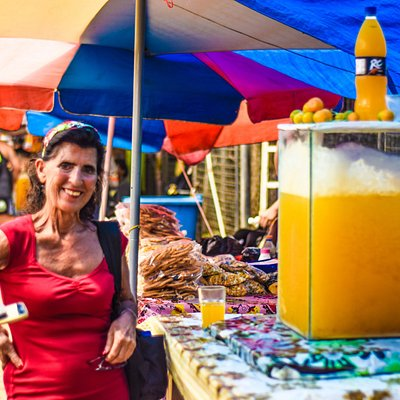 Traveler enjoying the local vibe and quenching on a fresh kumquat lemon juice from a local vendo