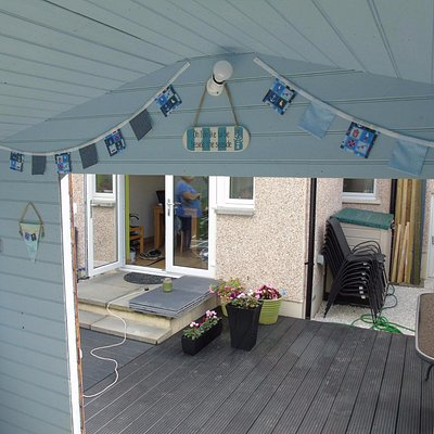 the bunting above the door and the small flags to the left are from podringtons