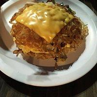 hashbrown with scrambled eggs, cheese, veggies. layered!