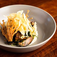 Sautéed field mushrooms and fried enoki with buttered vanilla parsnip