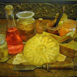 Antichi strumenti di lavoro, colori e resine naturali.