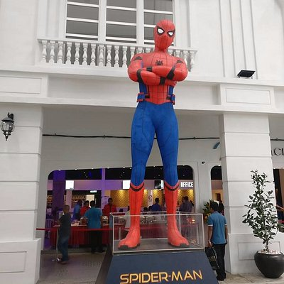 Spider Man welcoming the customer toward the cinema.